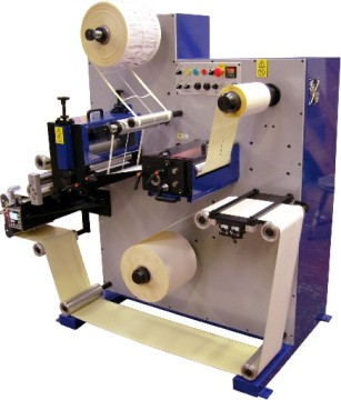 Daco 'D' label converter / rotary die cutter for the production of plain labels.  The machine is equipped with a single rotary die station, rotary slitting, a single product rewind and label counter.